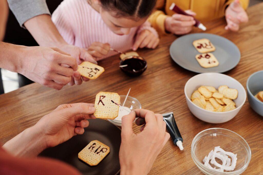 People writing RIP in fudge on cookies for Halloween