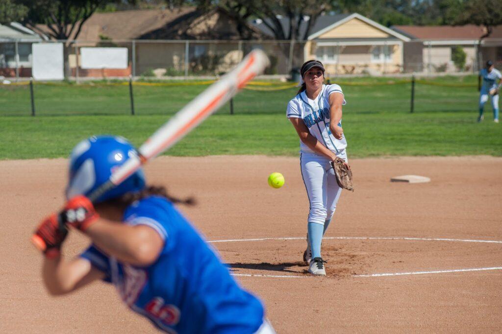 A pitcher pitching a ball